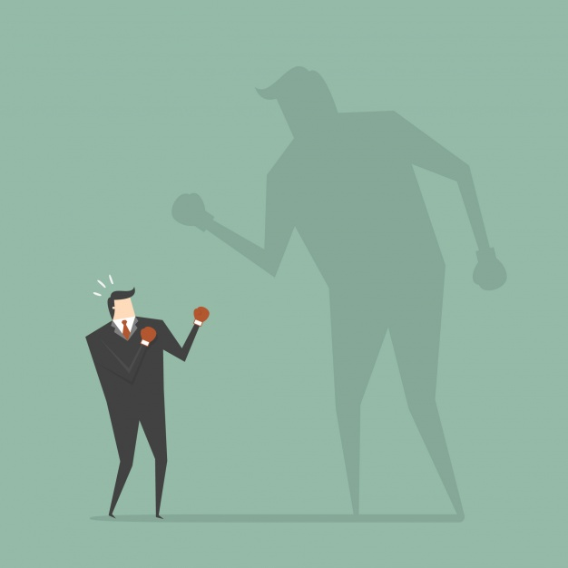 businessman-boxing-with-a-shadow
